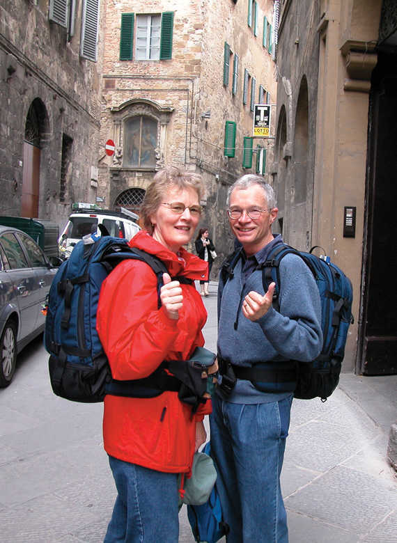 Couple Wearing Carry-On Packs
