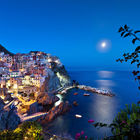 Manarola with moon light at night